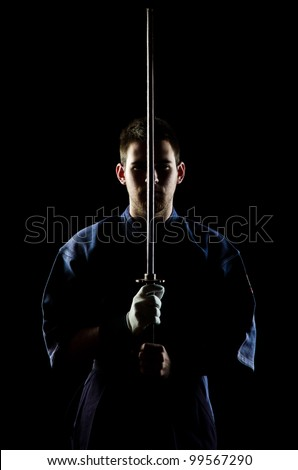 kendo fighter with bokken