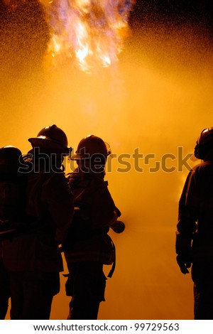 firefighters fight a blaze as a