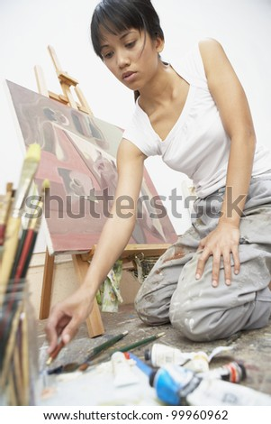 female artist painting