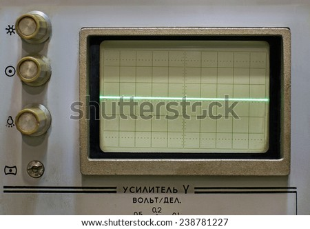 A horizontal bar on the screen of an old oscilloscope