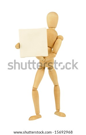 A wooden figurine holding a white  canvas