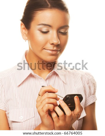 An attractive young woman makes notes on her PDA