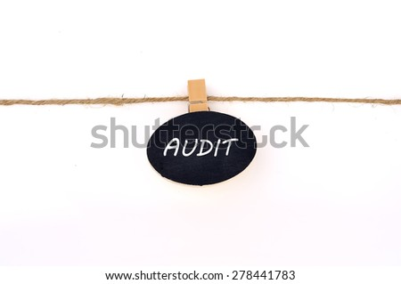 """AUDIT"" Word on Oval Shape Hang Note On White Background, Selective Focus"