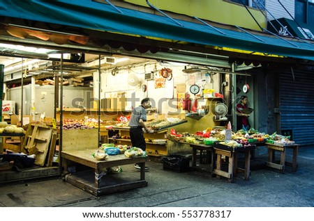30 AUG 2016. Editorial photo. The street market is organized by the asian immigrants on the street of Chinese district of Manhattan, New York, USA. The saling point in China