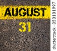31 August calendar day written over road marking yellow paint line - stock photo
