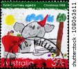 AUSTRALIA - CIRCA 1988: A stamp printed in Australia, shows Koala wearing a Santa hat, by Kylie Courtney, circa 1988 - stock photo
