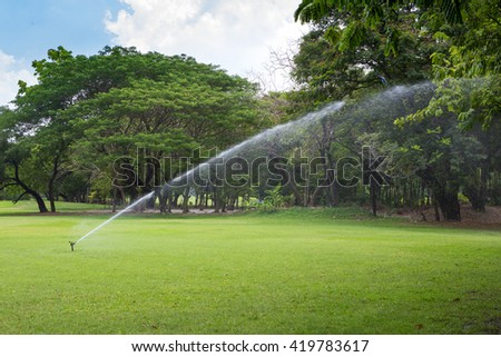 Automatic sprinklers watering lawns