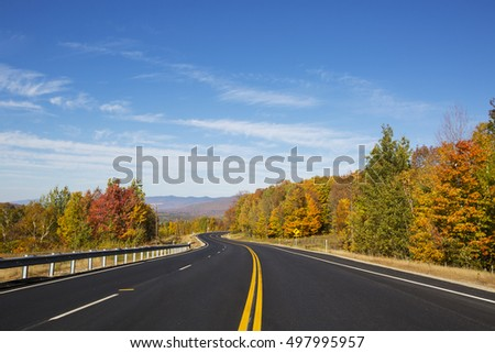 Autumn freeway in the mountain forest