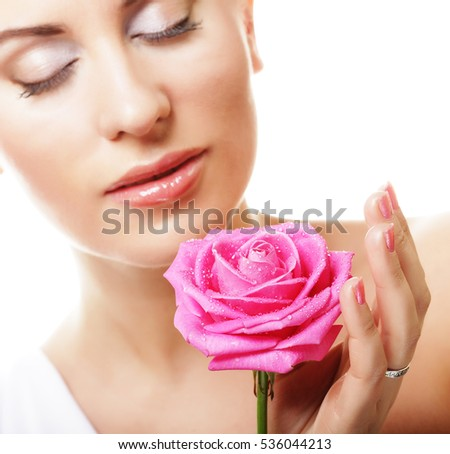 beautiful  young woman with pink rose