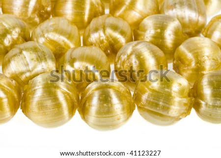 Border of candy caramel round fruit balls  heap close up isolated on a white background
