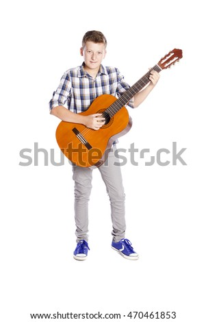 boy with a guitar isolated on white