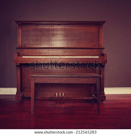 brown upright piano in a living room toned with a retro vintage instagram filter effect