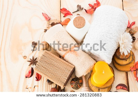 candle, cinnamon with towel on wood