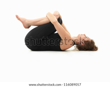 Caucasian woman on the floor in relaxed yoga pose side for Floor yoga poses