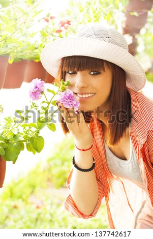 Cheerful Florist with Flowers