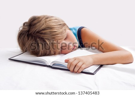 child sleeping with book