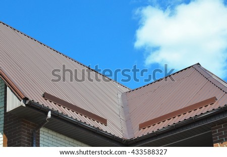 Closeup of problem areas for rain gutter system, roof waterproofing and roof protection from snow board (Snow guard) on new metal house roof construction