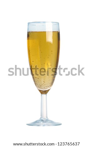Closeup of the bubbles in a glass of champagne on white background