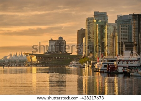 Coal Harbor Morning, Vancouver. Vancouver's city center and Coal Harbor at sunrise. Rowing team practice. British Columbia, Canada.