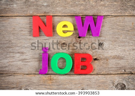 Colored Letter magnets spelling text NEW JOB
