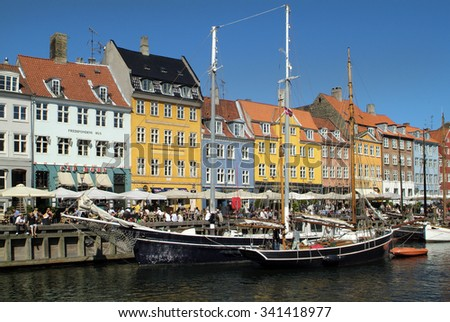 :COPENHAGEN, DENMARK - JUNE 23: Crowd of unidentified people in different restaurants in Nyhavn, meeting point and preferred tourist attraction of the city, on June 23, 2009 in Copenhagen, Denmark