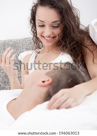 couple lying in bed in the bedroom