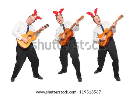 Crazy musicians in business suit with guitar singing. Christmas and new year party concept.