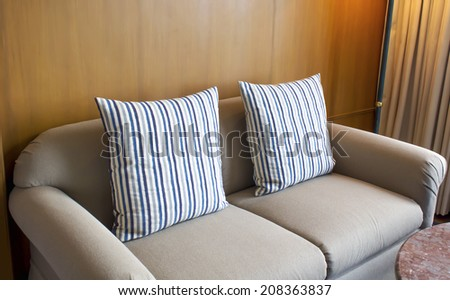 cushions on sofa in the living room at bed room