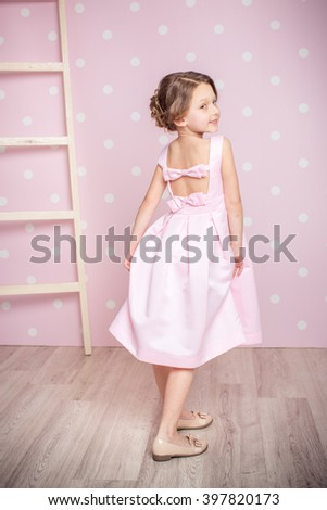 cute smiling little girl in princess dress