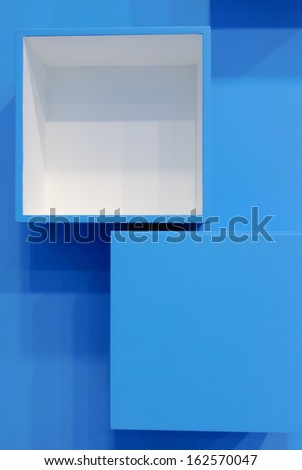 3D blue and white cubes in a random pattern on a blue background