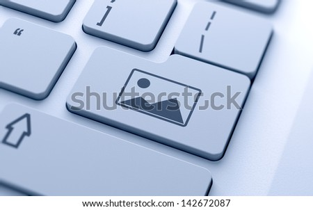 3d render of picture frame button on keyboard with soft focus
