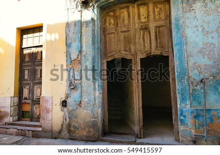 doors and entrances of  shabby collapsing houses of Havana, Cuba, an atmosphere of decay and poverty, ruined by embargo and communism