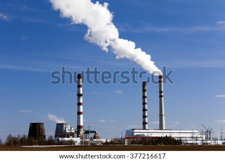 emissions from industrial plants against the blue sky.