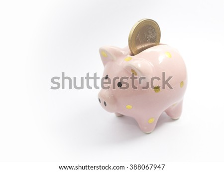 1 euro coin falling in piggy bank, isolated on white background