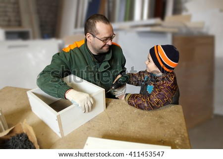 Father and son in a production workshop