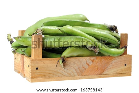 fava (broad) beans in crate isolated on white