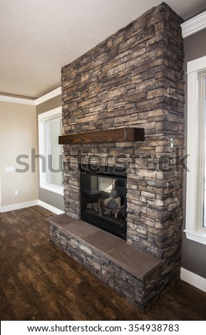 fireplace built with stone and wooden mantel