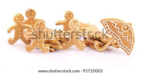 five gingerbread man with stars and umbrella