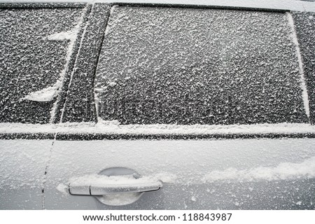 Frozen side window of  car closeup