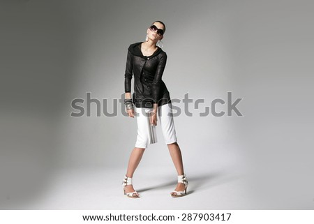 Full body portrait of young beautiful girl in sunglasses , Fashion photo