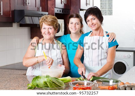 3 generation family cooking in kitchen