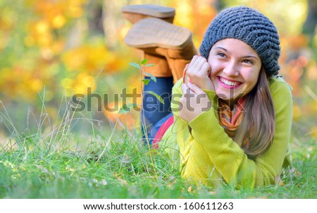 girl laying down in autumn time