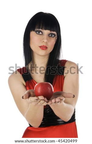 girl stretches a red apple