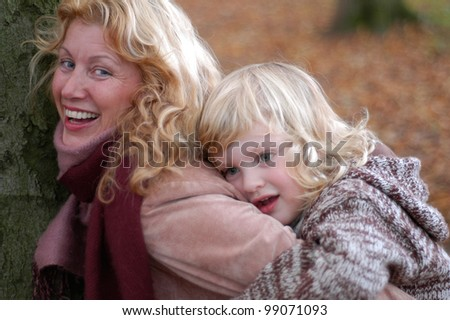 grandmother and grandson outdoors in autumn
