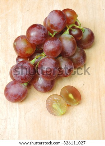 Grapes red,wood background.