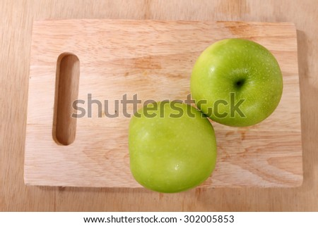 green apples in wooden plate