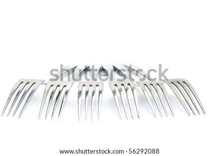 Group of Forks from the aged metal. Isolated on white