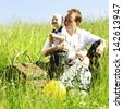 happy family on picnic in green grass - stock photo