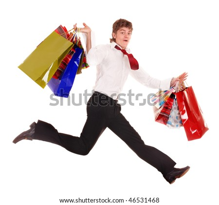 Happy man with shopping bag run. Isolated.