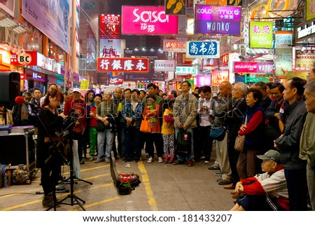 HONG KONG, CHINA - DEC 10:  Neon lights on Mongkok street on December 10, 2013 in Hong Kong. Mongkok street is a very popular shopping place in Hong Kong.